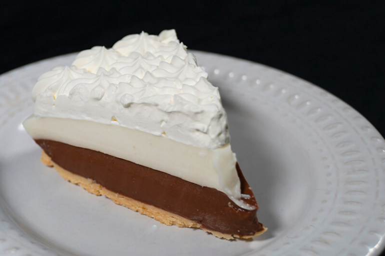 50 Best Places to Visit in Hawaii with your Family featured by top Hawaii blog, Hawaii Travel with Kids: Chocolate Haupia Pie from Ted's Bakery on Oahu