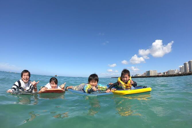 25 Amazing activities in Waikiki with kids featured by top Hawaii blog, Hawaii Travel with Kids: Family bodyboarding in Waikiki with kids