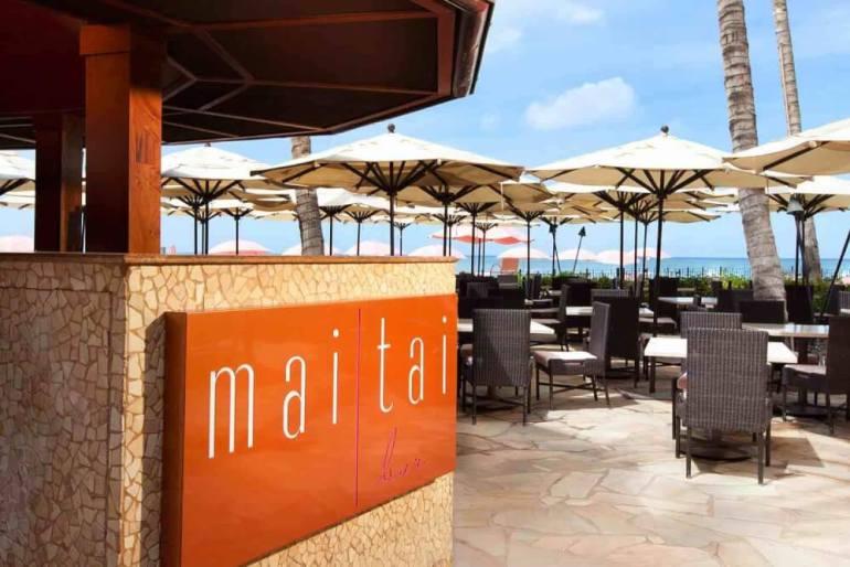 Top 8 Romantic Oahu Honeymoon Resorts featured by top Hawaii blog, Hawaii Travel with Kids: Mai Tai Bar at Royal Hawaiian Hotel