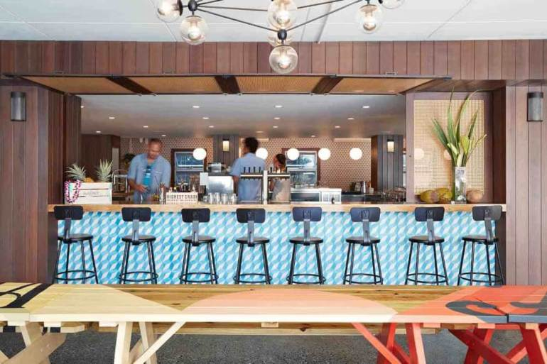 Top 8 Romantic Oahu Honeymoon Resorts featured by top Hawaii blog, Hawaii Travel with Kids: Surfjack Hotel and Swim Up Bar on Oahu
