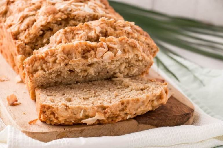 61 Delicious Coconut Dessert Recipes Perfect for Summer featured by top Hawaii blog, Hawaii Travel with Kids: This Coconut Lime Loaf is a one bowl easy to prepare quick bread. Brighten up your day with this vibrant Coconut Lime Loaf! #coconut #lime #easyrecipe #comfortfood