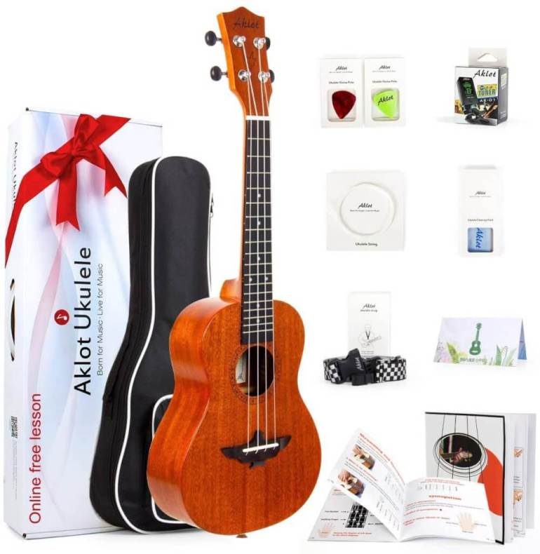 Find out the best kids ukulele to buy in this ukulele guide by top Hawaii blog Hawaii Travel with Kids. Image of Aklot Ukulele