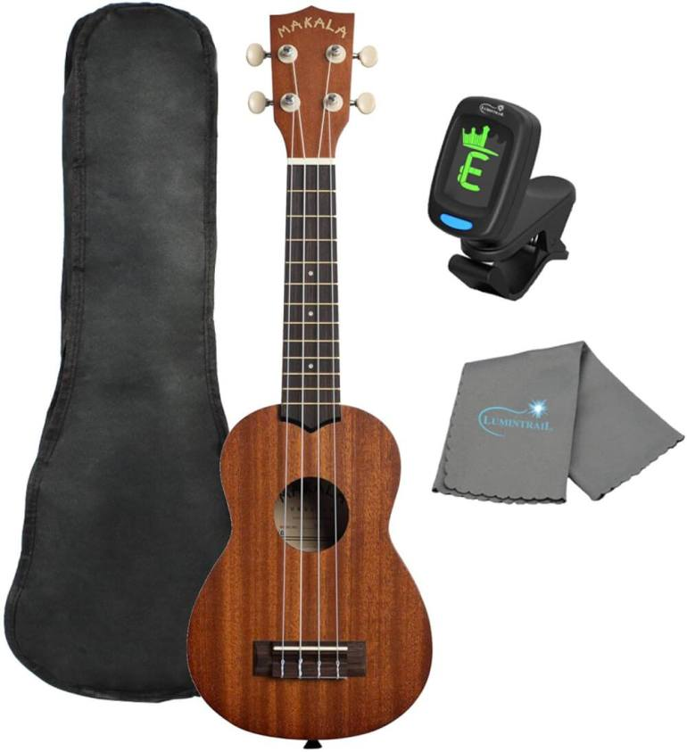 Find out the best kids ukulele to buy in this ukulele guide by top Hawaii blog Hawaii Travel with Kids. Image of Makala Ukulele Kit