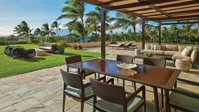 Top 5 Best Maui Luxury Hotels featured by top Hawaii blogger, Hawaii Travel with Kids: The Four Seasons Maui is a top Maui Luxury Hotel. Image of outdoor seating areas in Maui