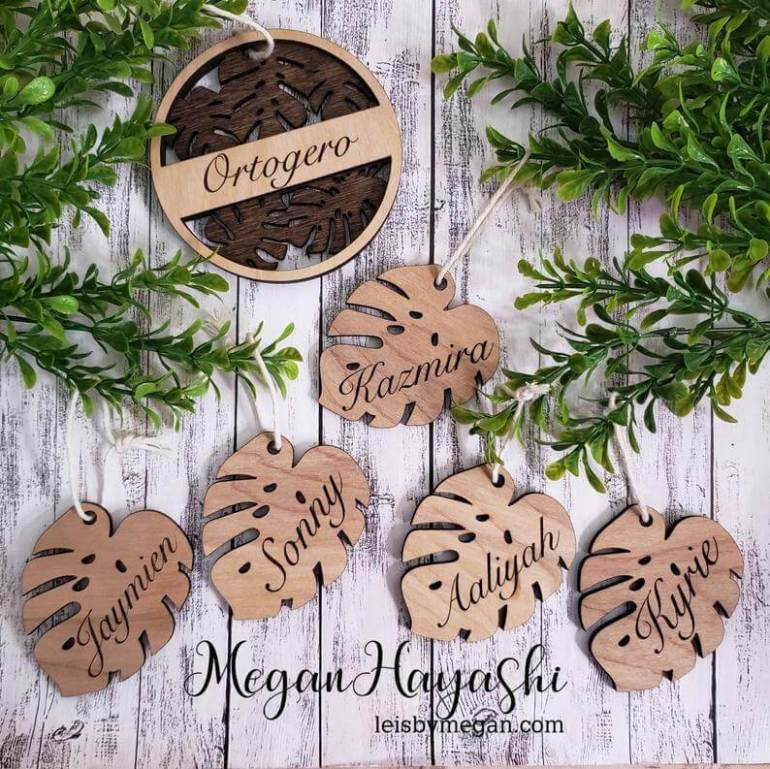 20 Hawaiian Christmas Ornaments featured by top Hawaii blogger, Hawaii Travel with Kids: Personalized Wooden Monstera Ornament Set personalized 5 monstera leaves