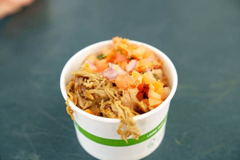 There are so many awesome Kauai food trucks to try! Image of a cup of kalua pork, lomi lomi salmon, and poi from Hanalei Taro and Juice Co Kauai food truck