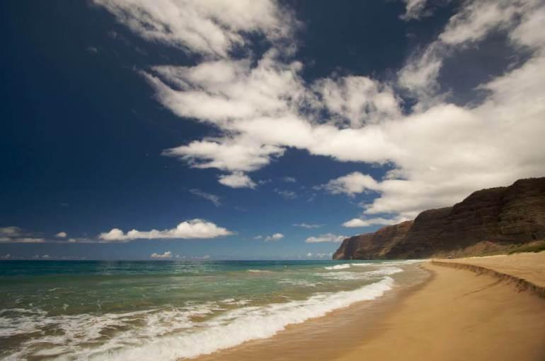 One of the best places to watch a Kauai sunset is Polihale Beach. Image of Polihale Beach on Kauai, Hawaii