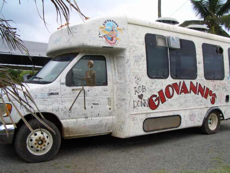 Giovanni's is one of the best North Shore food trucks. Image of Giovanni's Shrimp Truck on North Shore Oahu covered in signatures.