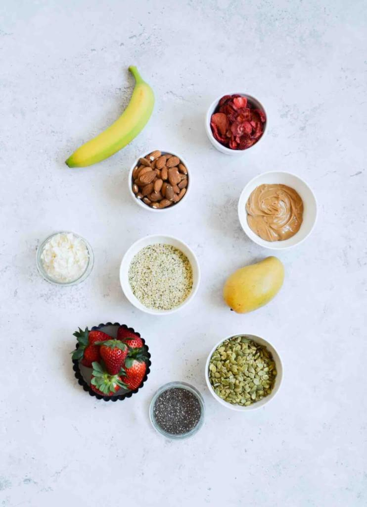Find out the best Strawberry Mango Smoothie Bowl toppings and ingredients to get. Image of frozen mango, strawberries, banana, coconut milk, chia seeds, nuts, etc.