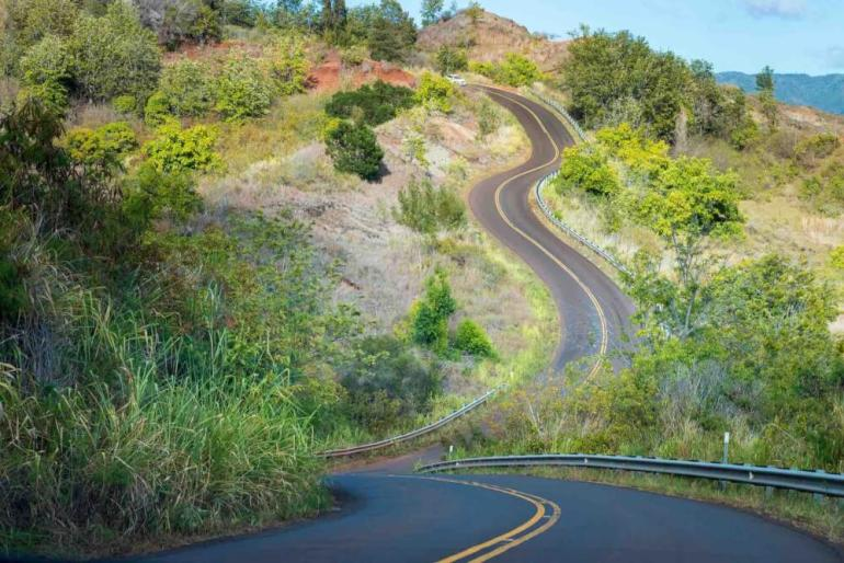 You might get car sick while driving to the Kalalau Lookout near Waimea Canyon on Kauai. Image of winding street to Kalalau Lookout on the Hawaiian island of Kauai, USA.