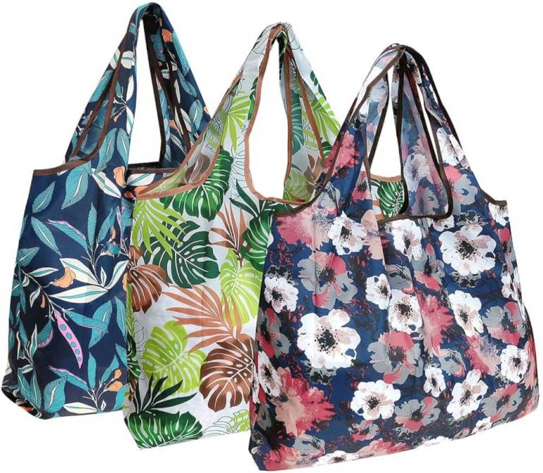 You'll need to bring your own bags to Hawaii. Image of 3 tropical reusable bags.