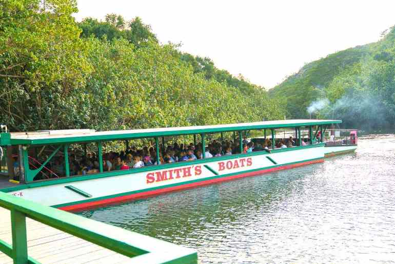 One of the best things to do on Kauai with toddlers is go on the Fern Grotto boat ride. Image of a river boat on the Wailua River on Kauai.