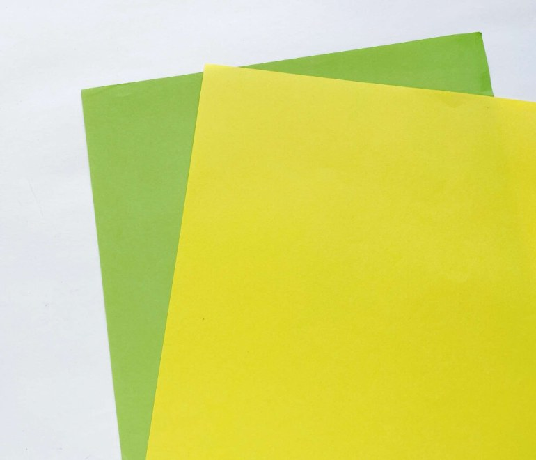 Choose yellow and green craft paper to make this easy pineapple paper craft idea.