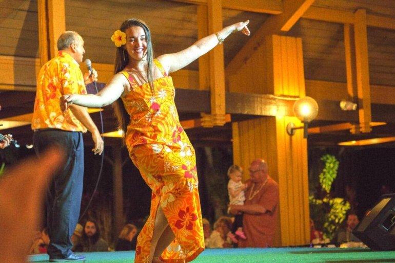 Image of a woman dancing hula at Smith's Family Luau on Kauai.