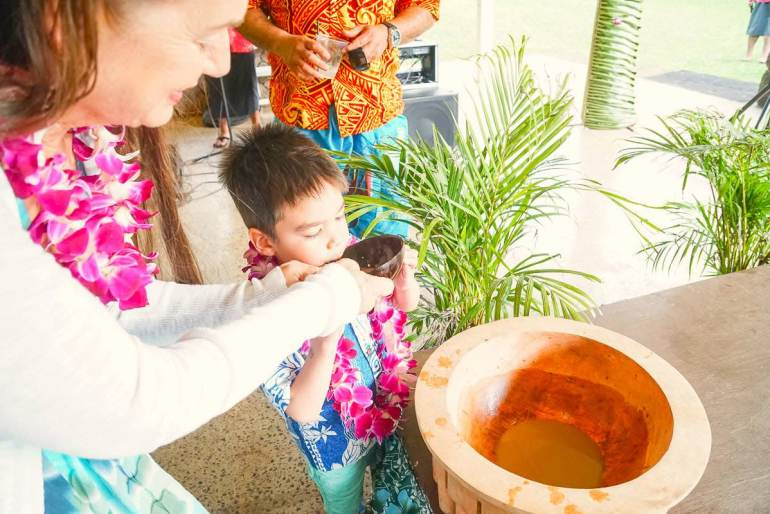 Toa luau is the best luau in Oahu North Shore that's intimate and affordable. Image of a boy trying kava at Toa Luau in Oahu.