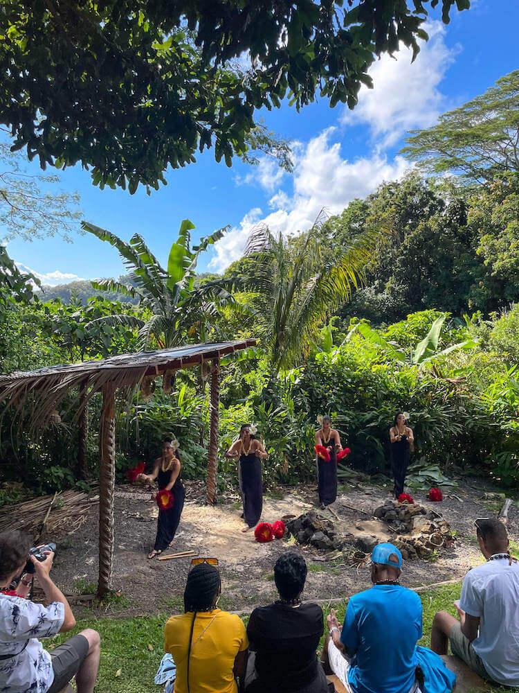 See what the Experience Nutridge Luau on Oahu is like by top Hawaii blog Hawaii Travel with Kids. Image of hula dancers performing at Nutridge Estate on Oahu.