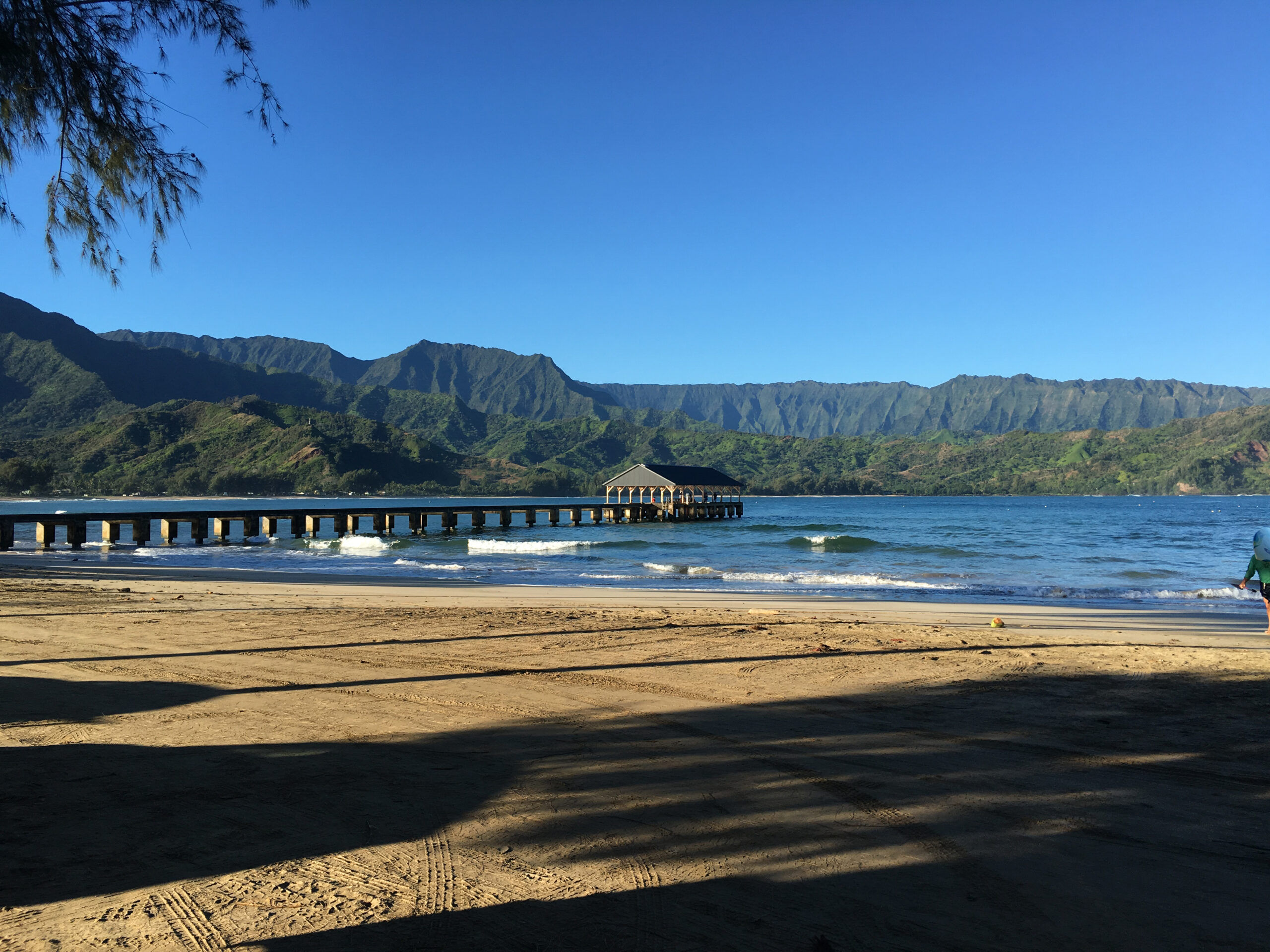 View of Hanalei Bay beach, pier and surrounding mountains