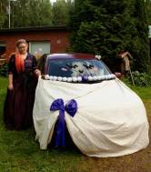 #23 - IMAGE: Prom Night! Get dolled up or decked out in your most fabulous prom-wear and pose for an awkward prom photo next to your date holding their… side-view mirror. A car must be formally dressed as your prom date.