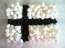 #127 - IMAGE: Make your country's flag from food or food packaging. (Finland)