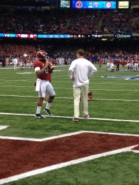 Quarterback and Offensive Coordinator have a casual conversation prior to kickoff against Ohio State.