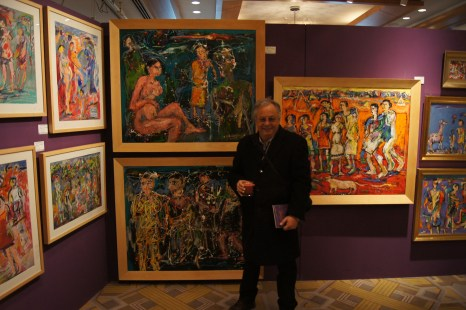 Ibrahim El Tanbouli standing in front of some of his work.