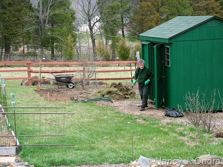Mom and the very green shed mid-April 2011