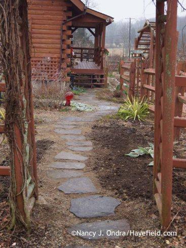Courtyard Path from barn December 2015; Nancy J. Ondra at Hayefield