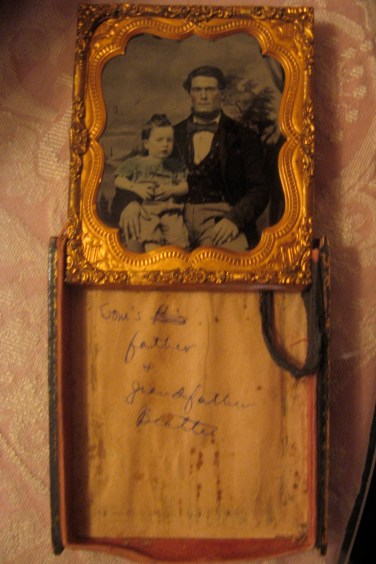 Jonathan J. Beattie and his son John with a note inside the frame