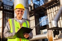 middle aged oil industry worker in refinery plant