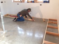 Tim making the base for the cabinets