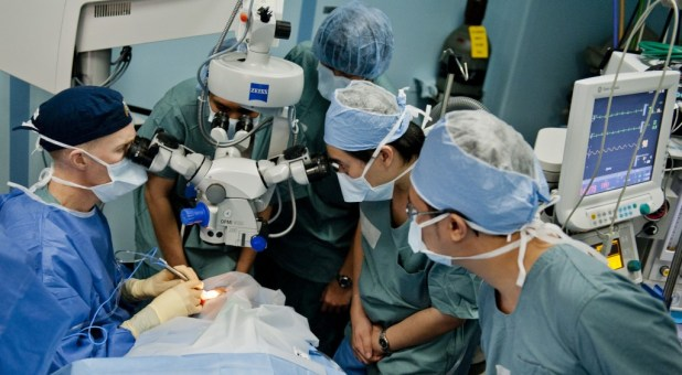 MANADO, INDONESIA (June 1, 2012) Cmdr. Brice Nicholson performs cataract surgery on an Indonesian patient as Indonesian optometry residents observe in an operating room aboard the Military Sealift Command hospital ship USNS Mercy (T-AH 19) during Pacific Partnership 2012. Now in its seventh year, Pacific Partnership is an annual U.S. Pacific Fleet humanitarian and civic assistance mission that brings together U.S. military personnel, host and partner nations, non-government organizations and international agencies to build stronger relationships and develop disaster response capabilities throughout the Asia-Pacific region. (U.S. Navy photo by Mass Communication Specialist 3rd Class Michael Feddersen/Released) 120601-N-GL340-085 Join the conversation http://www.facebook.com/USNavy http://www.twitter.com/USNavy http://navylive.dodlive.mil