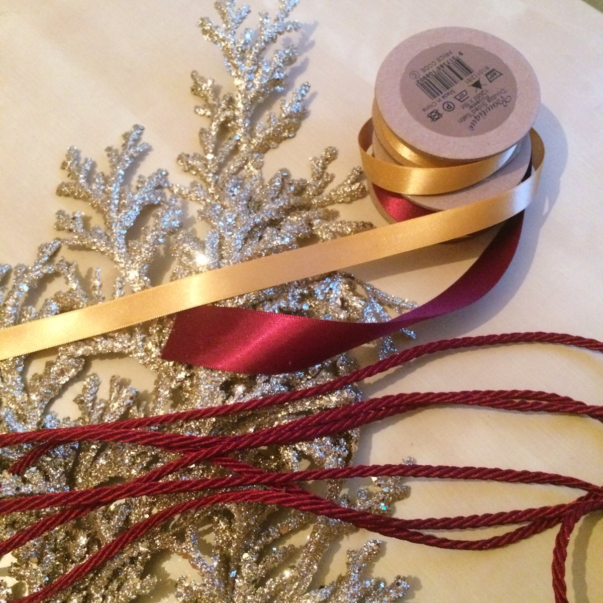 Maroon ribbon and gold branch accessories
