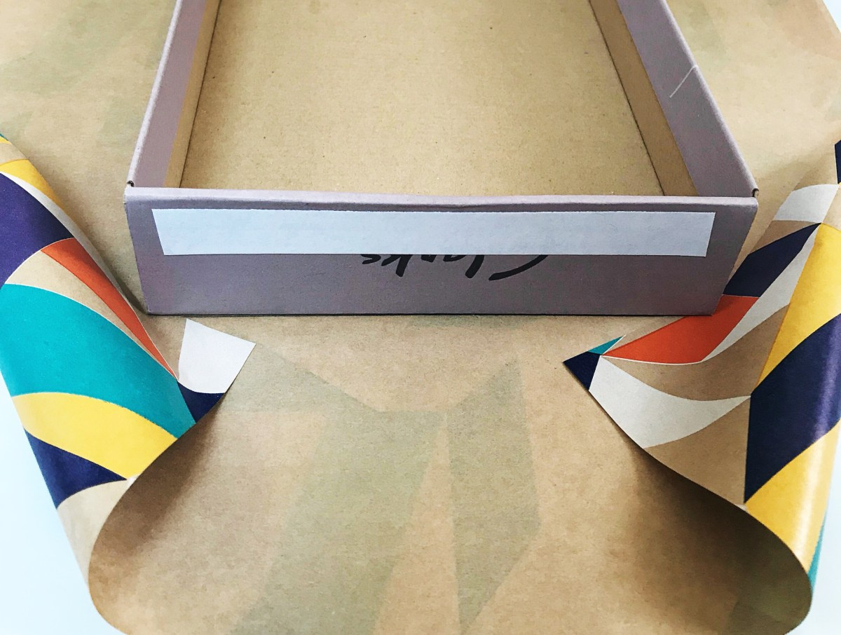 Clarks shoebox with double-sided tape on short end of box