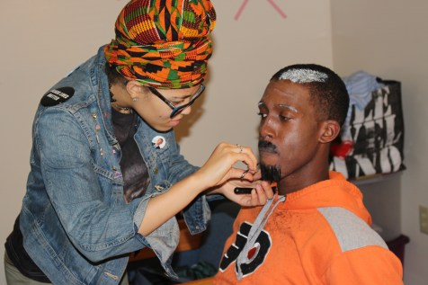 Pictured is Alabama State University alumnae makeup artist, Alexis Bassham creating a homeless personality for Tennessee State University student Zyhir Baker-Elam
