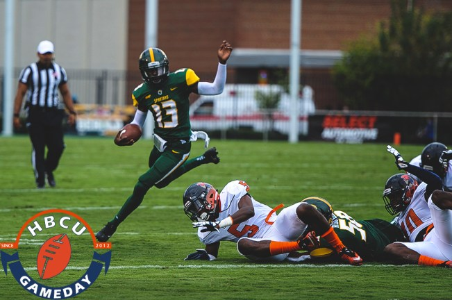 Tripp Harrington runs past VSU defenders. (Photo by Michael Peele.)
