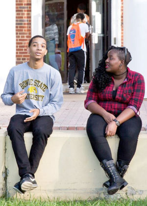 Bowie State University Students Converse on the Yard.