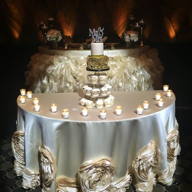 Elegant wedding came and wedding cupcakes with crystal topper