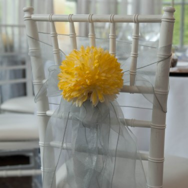 Yellow floral and ribbon wedding chair accent