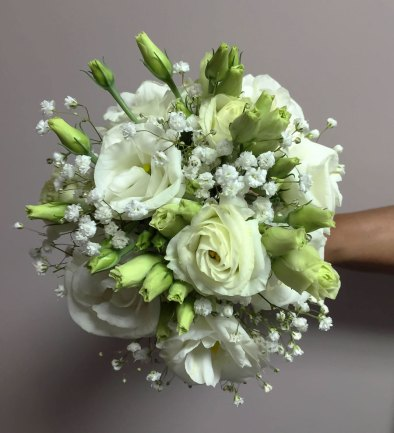 Bouquet of white roses with small white floral accents