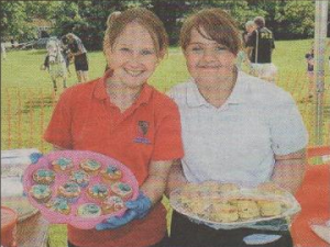 SWEET TREATS: Katie, 11 and Tilly, 11, at the cake stall