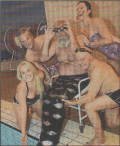 CHARITY: David the merman about to be launched into the pool by granddaughter Sascha and fellow Rotarians Mike Bantin, Piroska Cavell and Ted Rooney