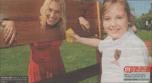 TAKING AIM: Sienna, 8, shows head teacher Yvonne Nunn her weapon