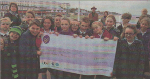 Pupils celebrate with the cheque