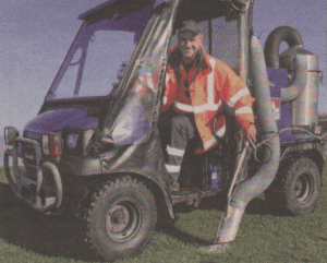 SCOOPER: Scott Hawkes with the Fido dog poo clearing machine at work on Tankerton Slopes