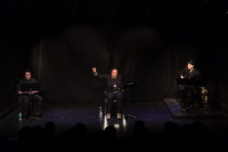 Three people on stage participate in a performance to benefit HB Studio, provider of NYC acting classes