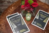 Several programs and flowers on a table at after-party ro benefit HB Studio, provider of acting classes in NYC