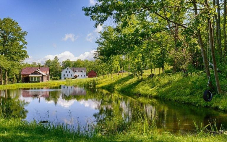 Image result for farmhouse reflected in a pond photo