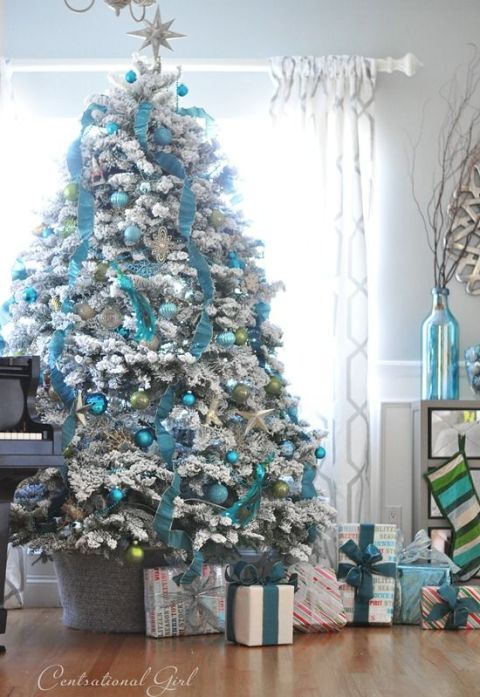 A white frosted tree has tons of combination possibilities           —  try mixing in pops of blue for an icy effect.  See more at Centsational Girl »