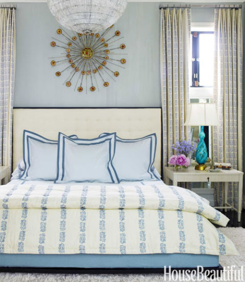 "For the master bedroom curtains and bedcover, a Rose Tarlow print, Sea Leaves, ""strikes the right balance between femininity and masculinity,"" Thomas says. They hang from custom Morgik metal rods. Shams and linens, Hillary Thomas Designs."