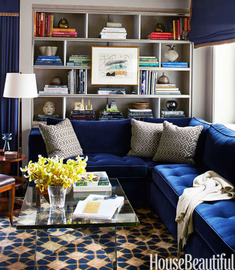 """I like to put the pattern on the floor and solids on the furniture,"" Phoebe Howard says. Family room rug by Tai Ping."